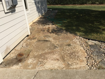 Stone was laid out and filled with sand to create a sturdy new patio surface!